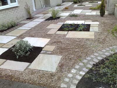 Gravel and Paving Patio with flowerbeds