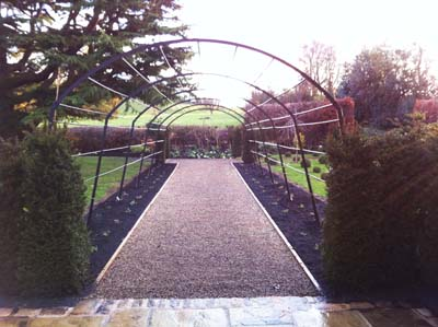 Bespoke Metal Arch over gravel path